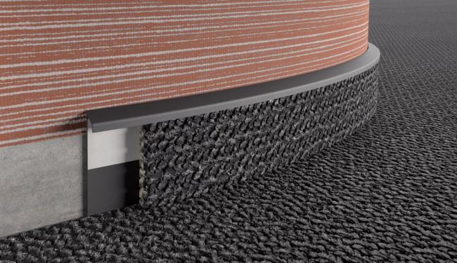 Плинтус для ковролина позволяет создать видимость целостности покрытия
