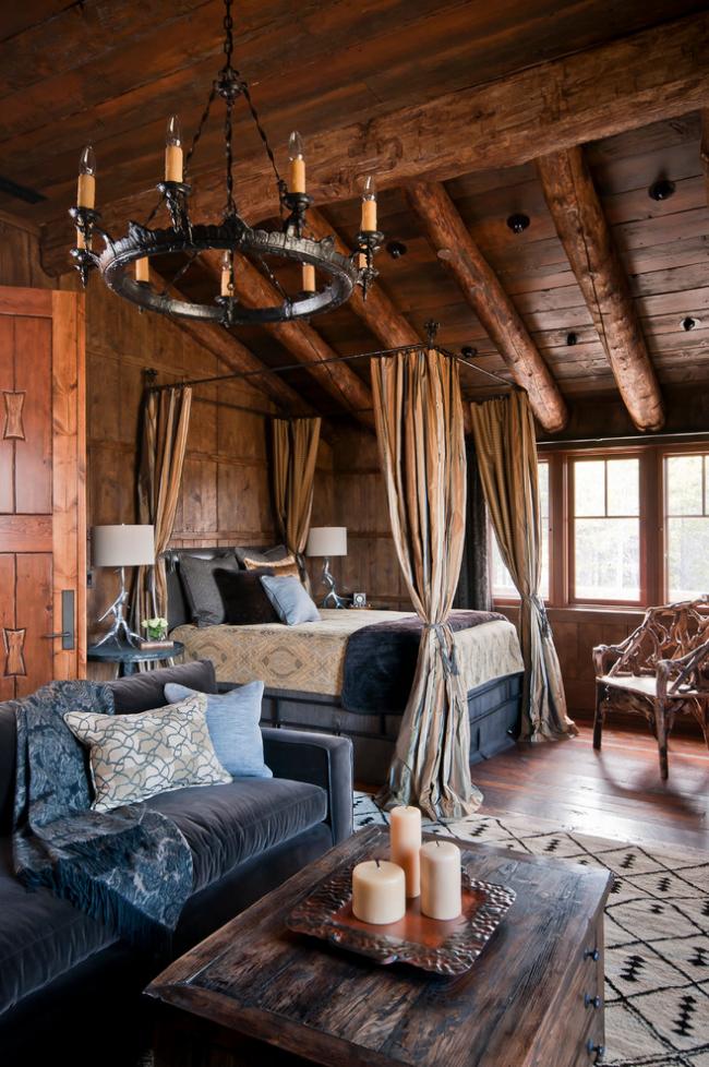 Красивая спальня-гостиная, оформленная в стиле рустика