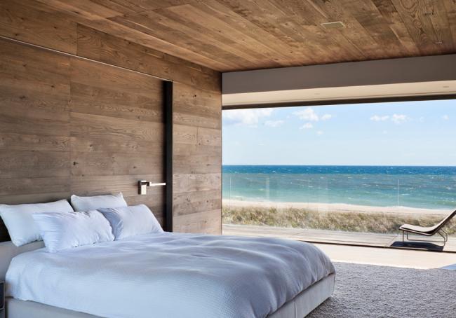Отделка спальни имитацией бруса делает комнату уютнее и теплее