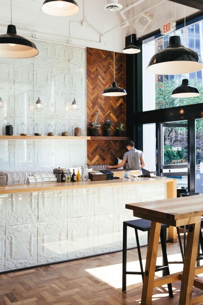 Декорирование стены гипсом в интерьере кухни в стиле лофт