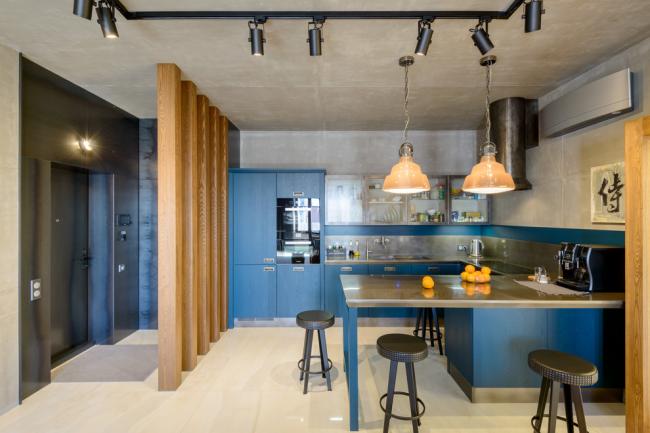 Голые бетонные плиты в интерьере кухни в стиле лофт