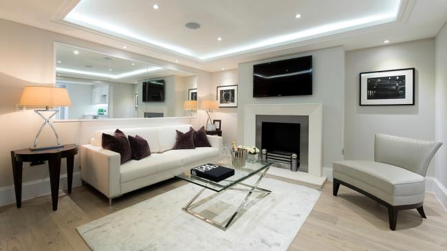 Белый цвет в отделке помещения поможет комнату сделать визуально просторнее