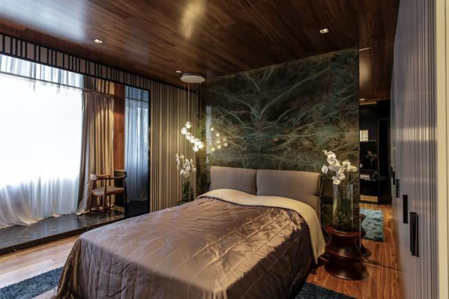 Роскошная спальня с двухместной кроватью в стиле модерн