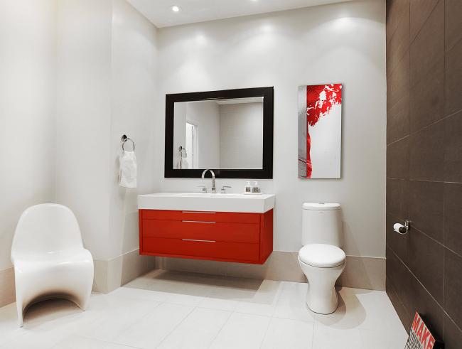 С помощью декоративной красной пленки можно преобразить тумбочку в туалете