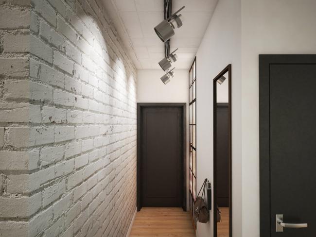 Светлые стены с кирпичной кладкой - маст-хев для узких прихожих