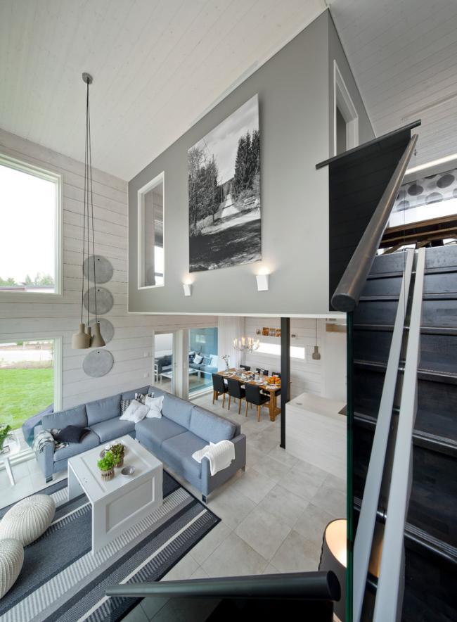 Зонирование кухни-гостиной можно сделать с помощью углового дивана