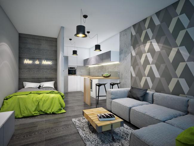 Квартира-студия в сером разбавлена элементами сочного зеленого цвета