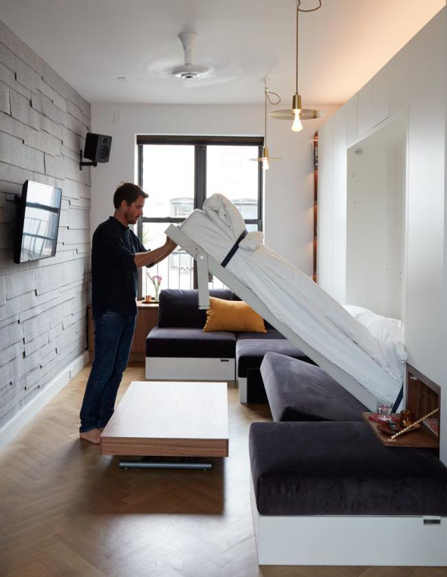 Функциональная шкаф-кровать в интерьере в стиле лофт