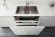 Фото 18 Минимализм в тренде: обзор элегантных кухонь без ручек и варианты их механизмов