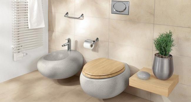 Имитация камня в форме и материале туалетного оборудования