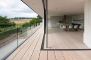 Фото 31 Дизайн кухни с выходом на балкон: лучшие идеи планировки, утепление и выбор функциональной мебели