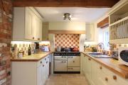 Фото 9 Дизайн кухни 11 кв. метров: трендовые интерьерные новинки и современные планировки
