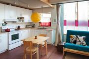 Фото 1 Кухня-гостиная площадью 12 кв. м: создаем продуманный интерьер от минимализма и хай-тека до классики и лофта