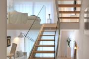 Фото 6 Лестницы из стекла: все, что нужно знать о монтаже и эксплуатации