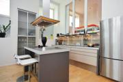 Фото 18 Островные вытяжки для кухни: ТОП-5 популярных моделей на рынке