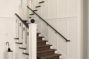 Фото 3 П-образная лестница на второй этаж: виды конструкций и особенности выбора материалов
