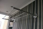 Фото 19 Лиана для сушки белья на балконе: обзор конструкций и варианты установки