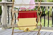 Фото 8 Лиана для сушки белья на балконе: обзор конструкций и варианты установки