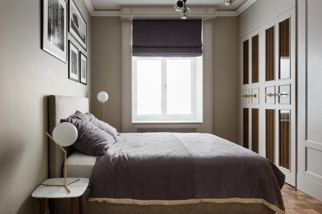 Спальная комната, оформленная в пастельных тонах