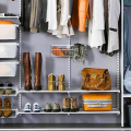 Компактное хранение: выбираем функциональный шкаф для пылесоса и гладильной доски фото