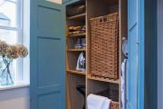 Фото 5 Компактное хранение (75+ идей): выбираем функциональный шкаф для пылесоса и гладильной доски