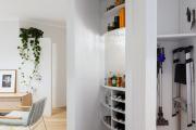 Фото 7 Компактное хранение: выбираем функциональный шкаф для пылесоса и гладильной доски