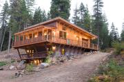 Фото 30 Строительство дома на склоне: обзор проектов, способы и особенности возведения