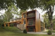 Фото 32 Строительство дома на склоне: обзор проектов, способы и особенности возведения