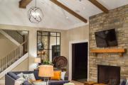 Фото 12 Секреты гармоничного и удобного дизайна гостиной с телевизором над камином