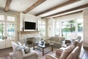 Фото 1 Секреты гармоничного и удобного дизайна гостиной с телевизором над камином