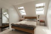 Фото 13 Планировка и дизайн квартир с выходом на крышу: тренды и советы дизайнеров