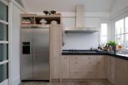 Фото 12 Встроенный в шкаф холодильник: выбор техники и виды установки для максимального комфорта