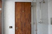 Фото 1 Межкомнатные двери из экошпона: советы по выбору и как сэкономить на покупке двери?