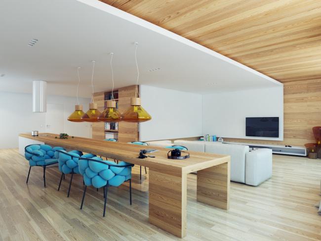 Стильная кухня, объединенная с уютной гостиной
