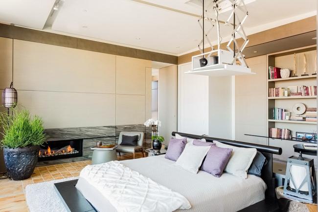 Проектор в современной светлой спальне