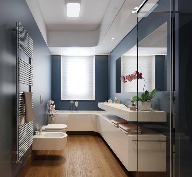 Просторная ванная комната, в интерьере которой выгодно разместилась вся необходимая сантехника