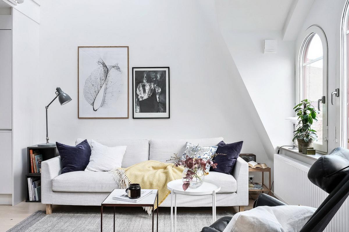 Интерьер гостиной загородного дома в скандинавском стиле