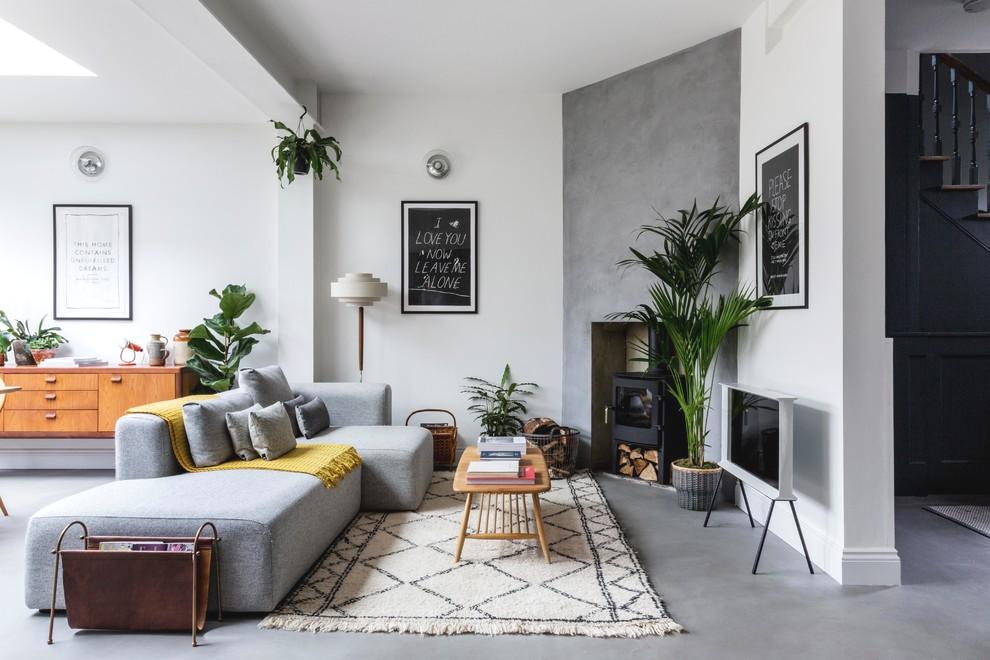 Разделение кухни и гостиной с помощью дивана в интерьере квартиры-студии